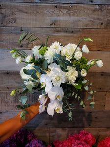 A beautiful example of a white and green bouquet. Lisaenthus, Roses, Dahlias, Hydrangeas, Orchids and Eucalyptus are all part of this.