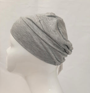 "The ""Pyramid"" is a  classy, easy to wear turban and has full head coverage.  With elastic in the back for a secure comfortable fit.   Dress it up with an accent scarf or broach and it  will take you anywhere."