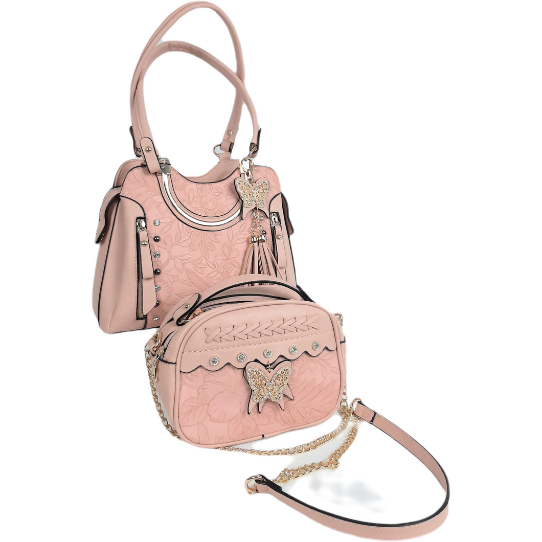 Two handbags for the price of one!  Stylish blush handbag with embossed leaf pattern, tassels, crystal detail and gold tone hardware.   Optional shoulder strap.
