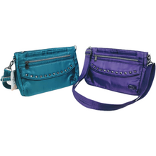 "Load image into Gallery viewer, From morning coffee to a fun night out, stay on pace with your busy day. This stylish studded slim bag is packed with pockets for your all-day essentials.  Dimensions: 10.25""W x 7.5""H x 2.5""D. Available in grey, grape, teal."
