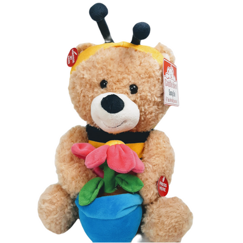 Soft beige plush bear dressed as a bee holding a flowerpot that sings you are my sunshine