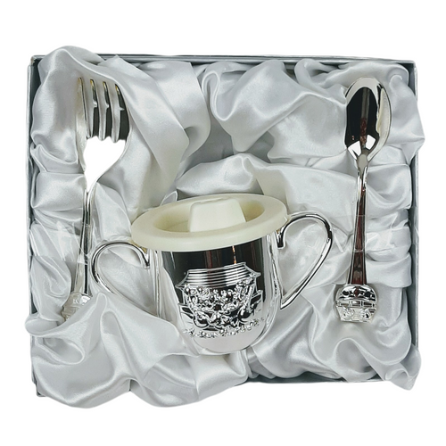 Three piece baby gift set featuring Noahs Ark motif on silver finish lidded cup, spoon and fork.