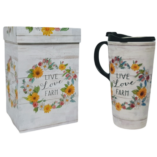 17 ounce ceramic travel mug.  Off white washed background with colourful  sunflower and daisy wreath and Live, Love, Farm in black lettering inside.  Black handle and lid.  Full colour matching gift box..