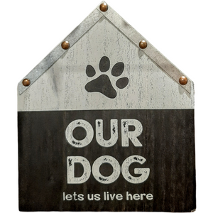 Wooden house shaped flat wall sign balck and white our dog lets us live here.  7 inches by 8 inches.