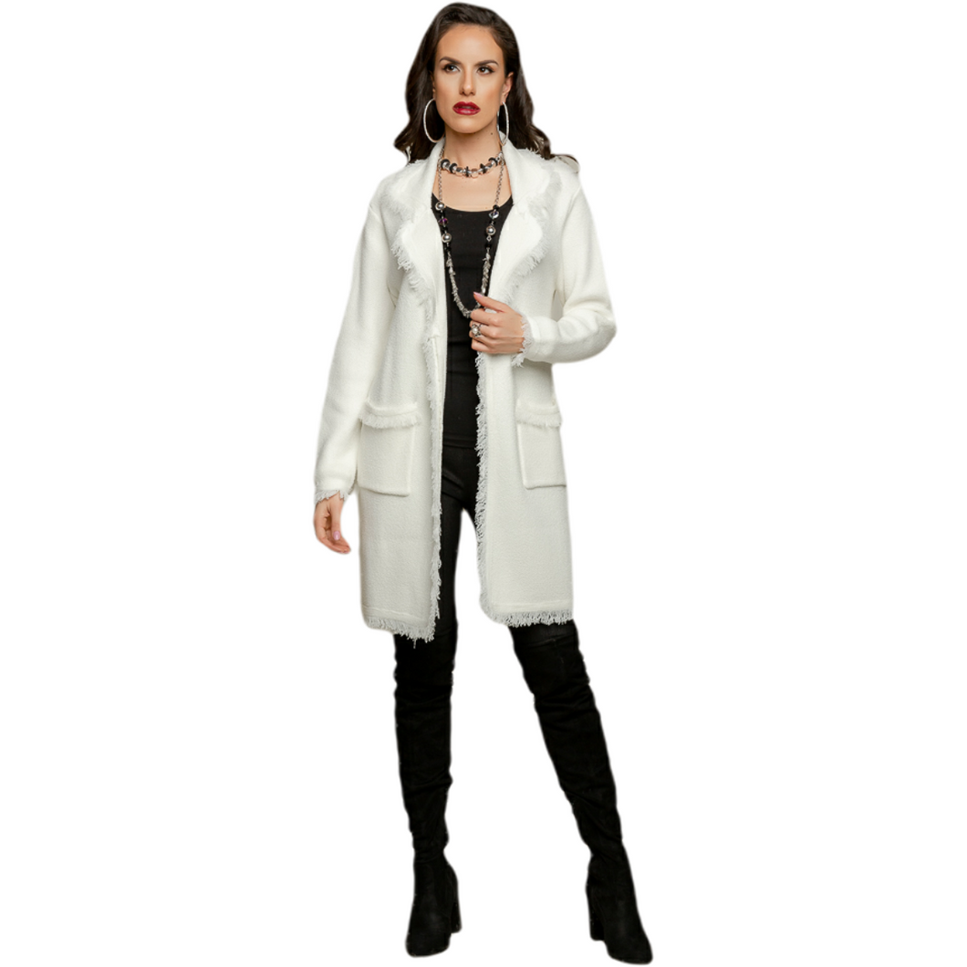 Cozy and soft winter white mid thigh length sweater coat, open style with patch pockets and fringe detail on edges.