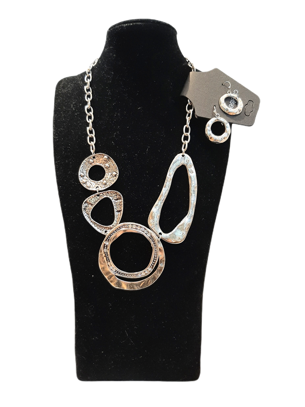 Stylish hammered silver tone necklace and earring set with crystal accents..  Nickel free.