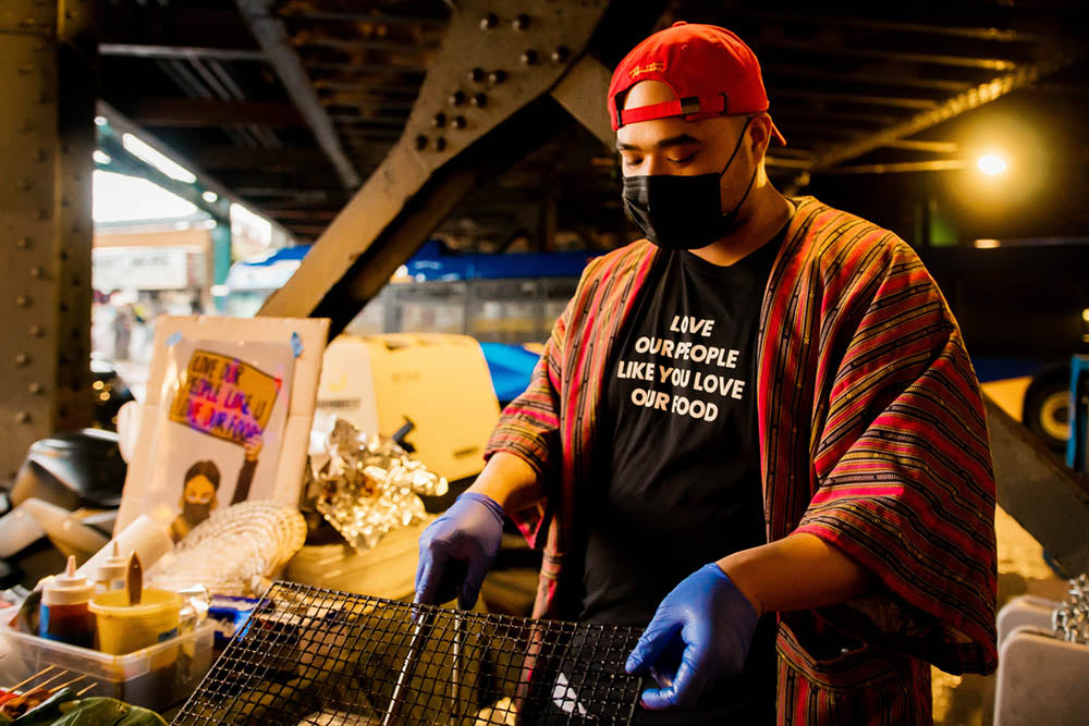 Chef Francis making food at his pop up shop in Queens
