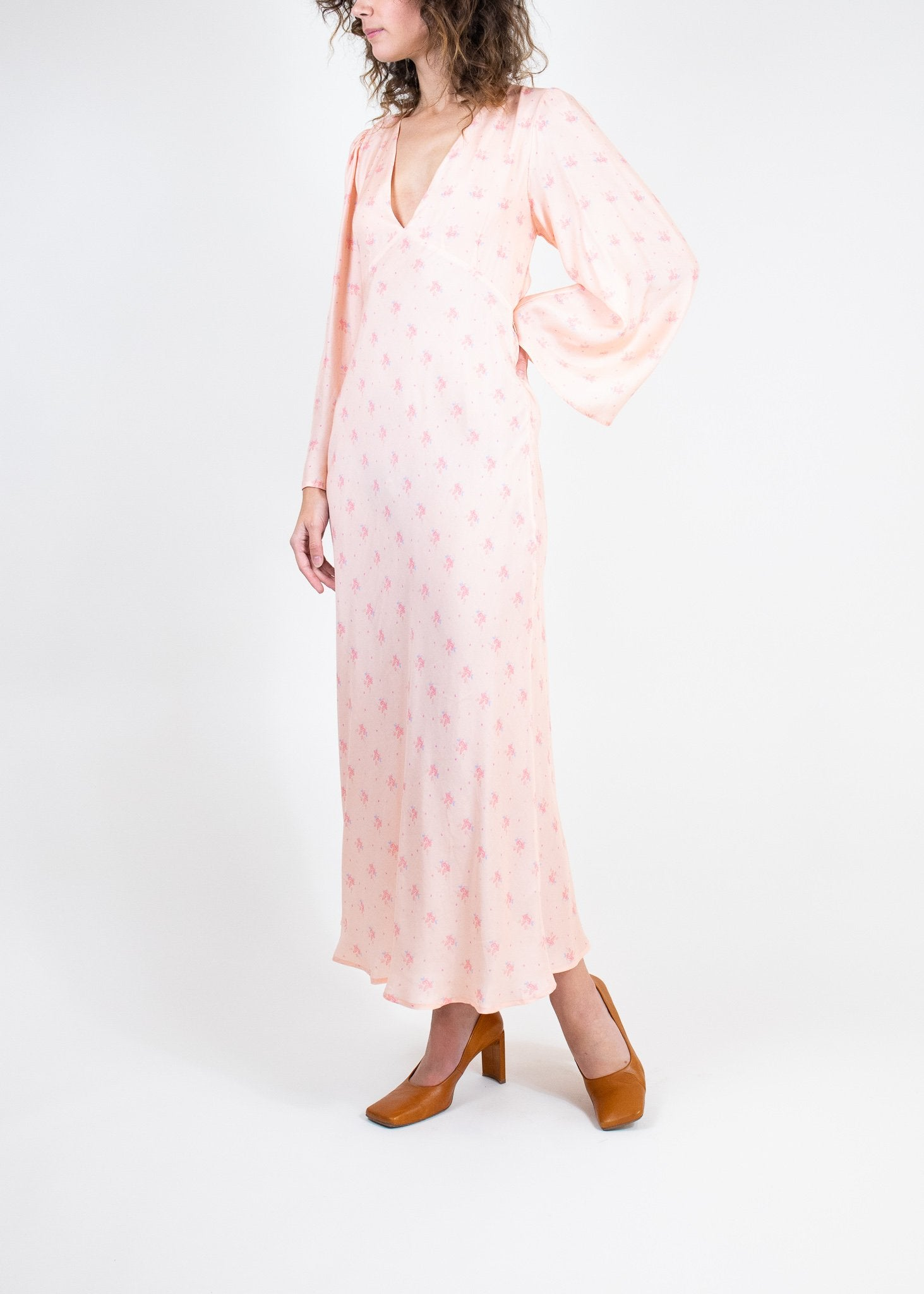 Rent RIXO Peach Tie Back Long Sleeve Midi Dress from Rotaro