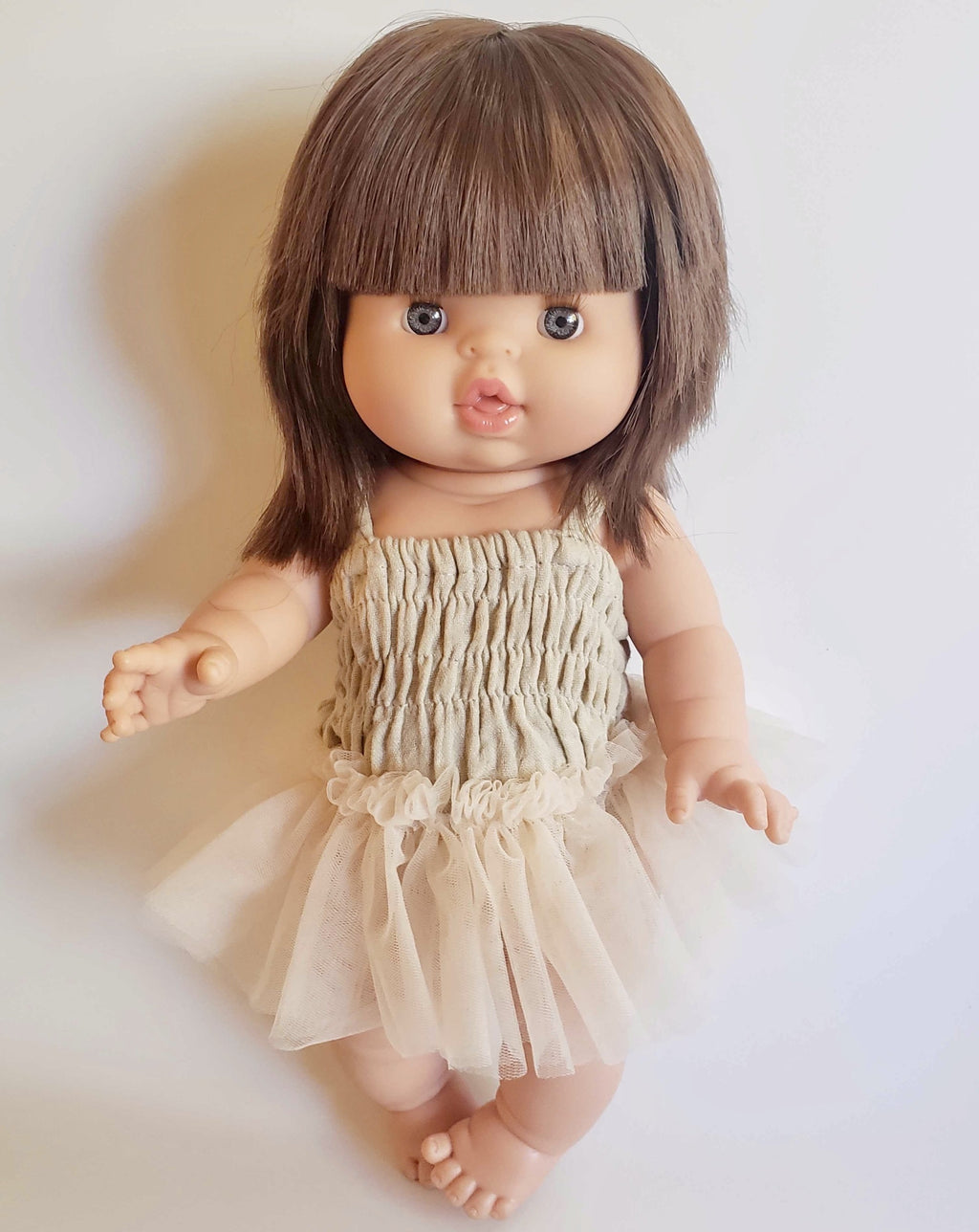 Brunette baby doll with hair, the newest minikane Chloe doll.