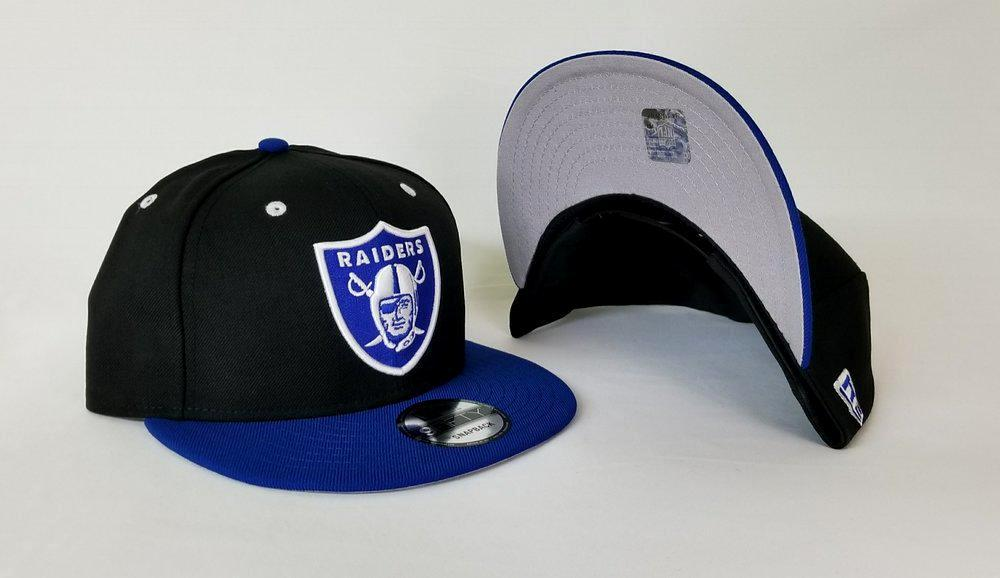 New Era NFL Shield Oakland Raiders 9Fifty Snapback Hat Dark Black / Royal Blue