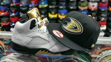 "Load image into Gallery viewer, Matching New Era Anaheim Ducks 9Fifty snapback for Jordan 5 ""Olympic"" Black gold"