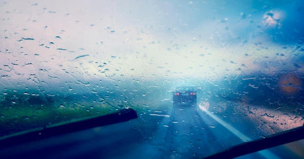 Highway view on a rainy day from a car's front seat