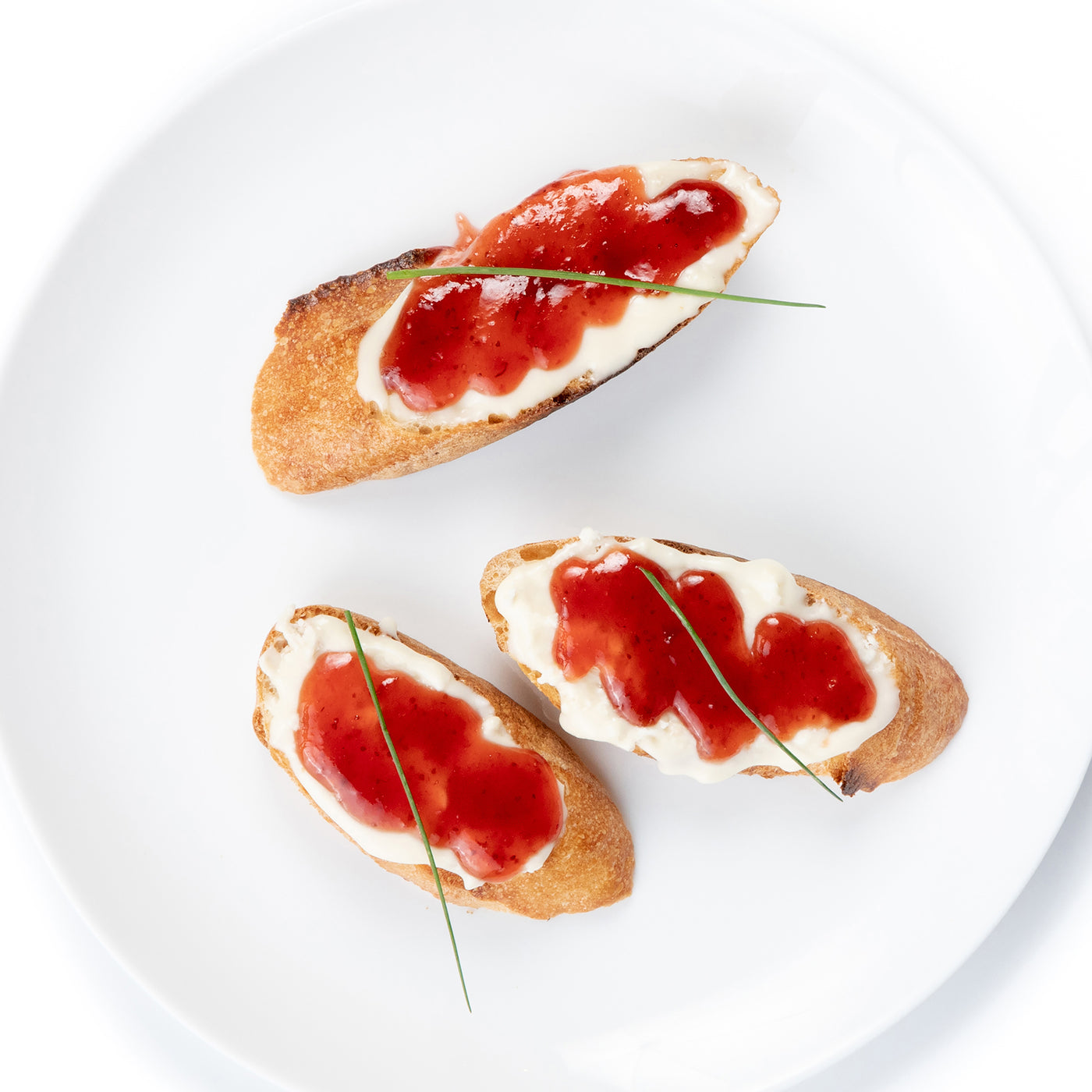 Fire-Roasted Brie Crostini with Strawberry & Rose