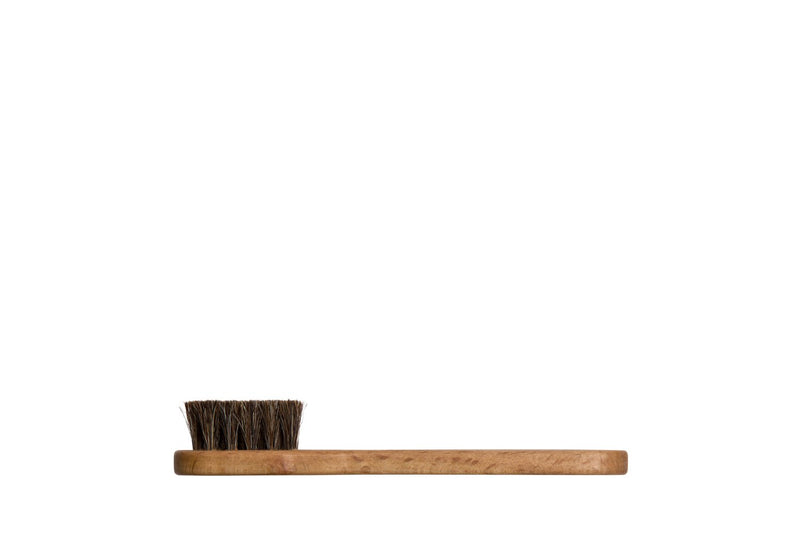 Small wooden shoe cleaning brush