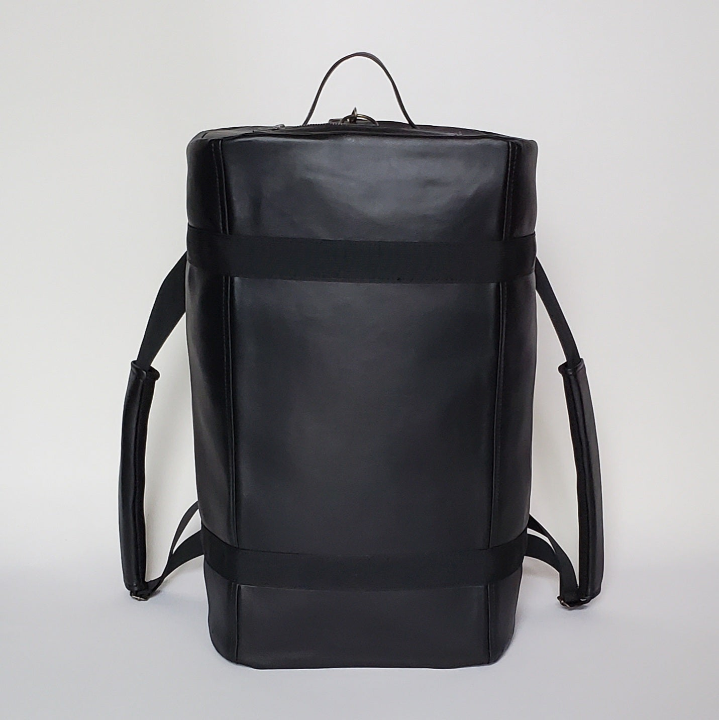 Black Faux Leather Duffel Backpack
