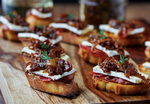 Bruschetta with Sundried Tomato Pesto & Caramelized Onions