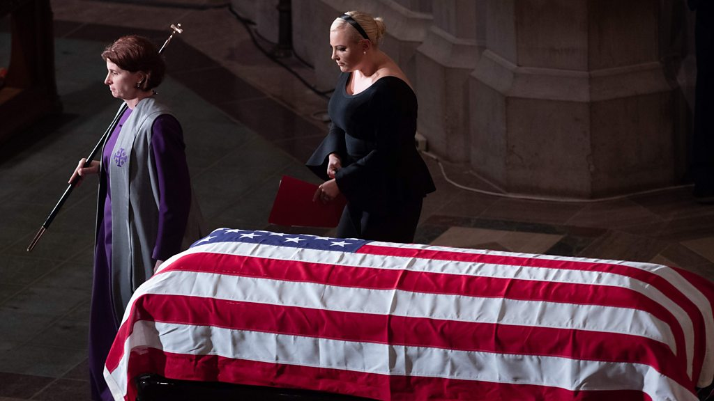 John McCain funeral image of wrinkled flag conspiracy theory