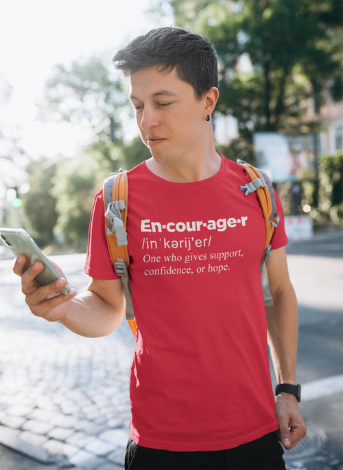 guy wearing a t-shirt with the definition of encourager on it.