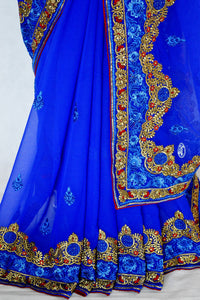 Pleasing Blue,Gold & Red Party Wear Saree