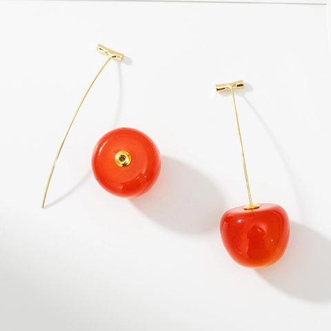 Cherry earrings with stem removed to demonstrate how they can be worn
