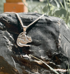 https://calithien.com/collections/storybook-collection/products/i-am-fire-sleeping-silver-dragon-pendant
