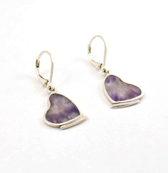 Front of chevron amethyst inlay earrings shaped like butterflies with their wings folded.  Sterling silver.