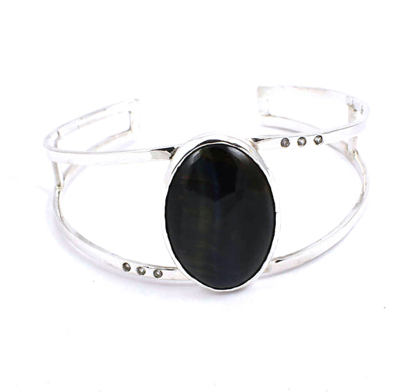 Front view of sterling silver cuff bracelet with hawk's eye and white sapphires
