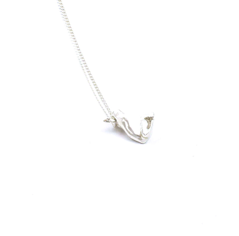 Left side view of sterling silver frog prince pendant