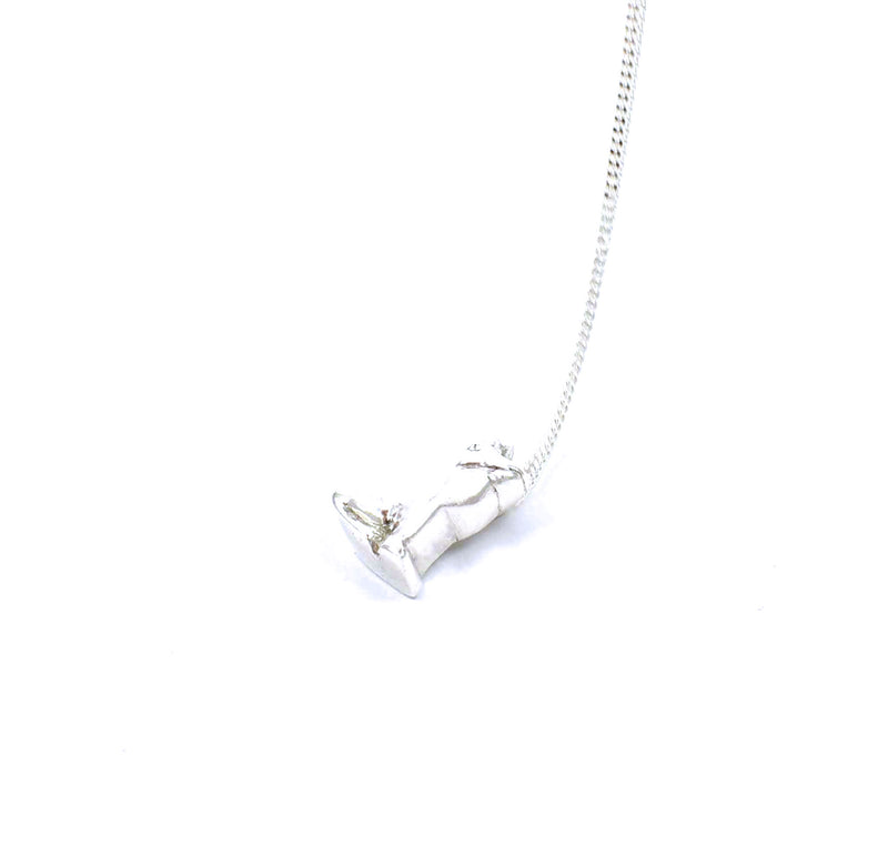 Right side view of sterling silver frog prince pendant