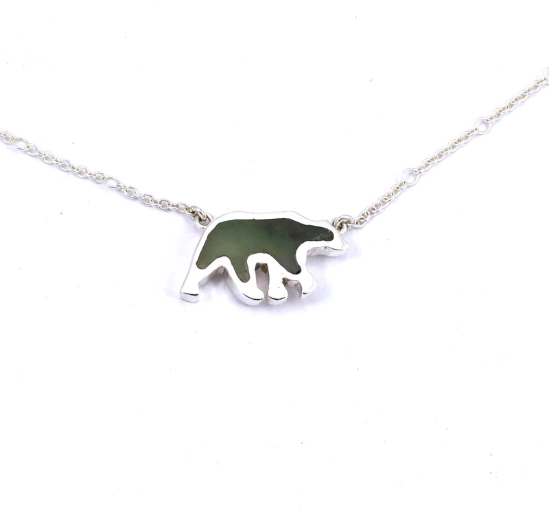 Front view of sterling silver bear pendant with jade gemstone inlay