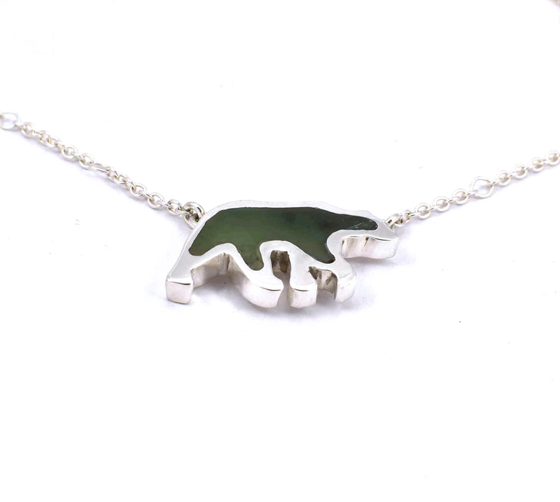 Bottom view of sterling silver bear pendant with jade gemstone inlay