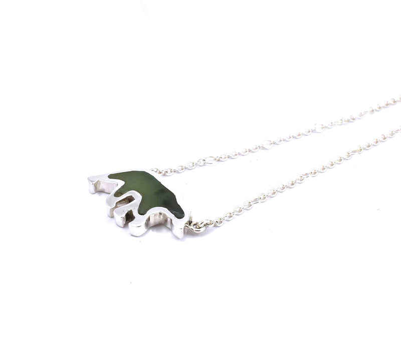 Right side view of sterling silver bear pendant with jade gemstone inlay