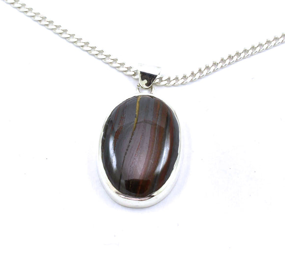 Oval Tiger Iron/ Mugglestone cabochon pendant in sterling silver setting.