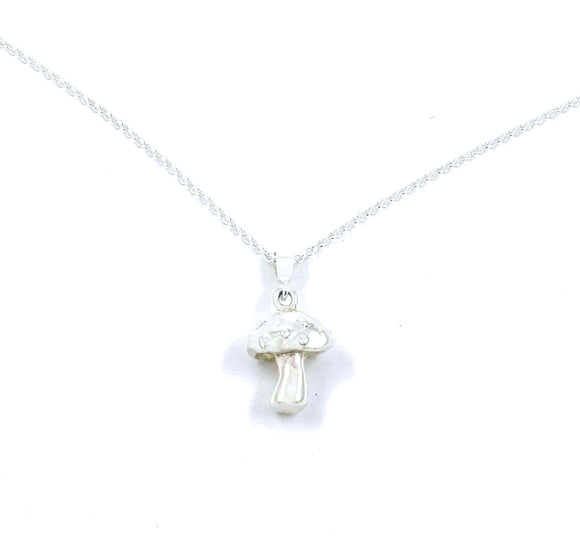 Sterling silver pendant shaped like a 3D mushroom with spots