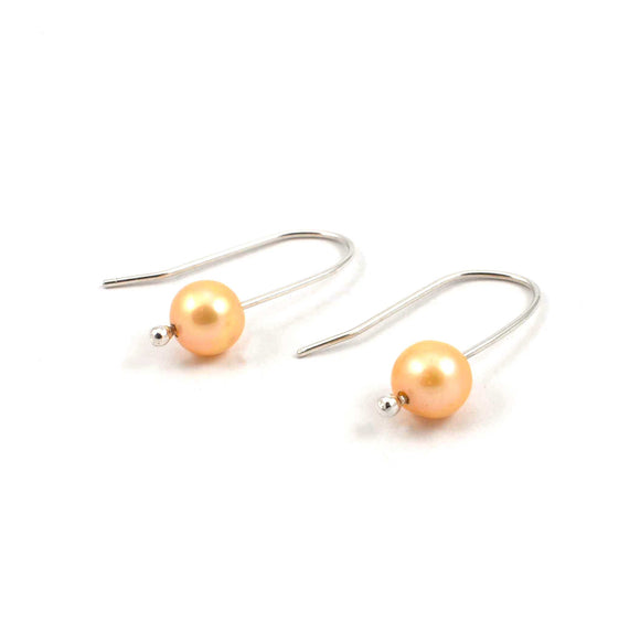 Front view of long champagne freshwater pearl drop earrings