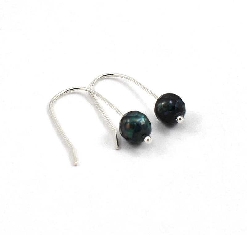 Side view of long green faceted freshwater pearl drop earrings