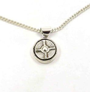 Sterling silver pendant shaped like a round shield