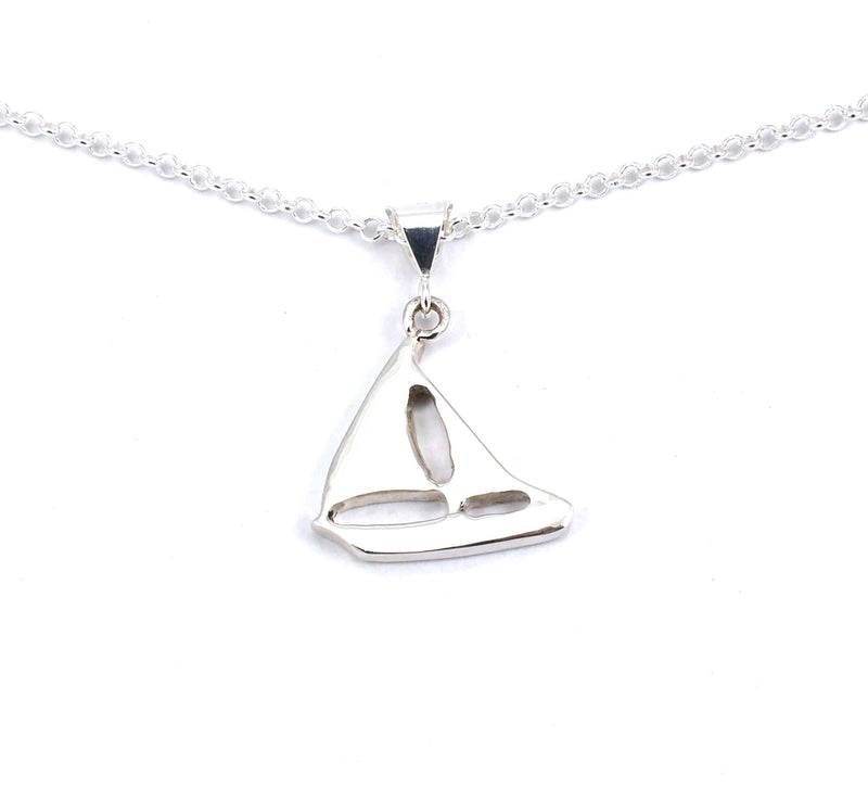 Rear view of sterling silver sailboat pendant with hawkseye and mother of pearl gemstone inlay