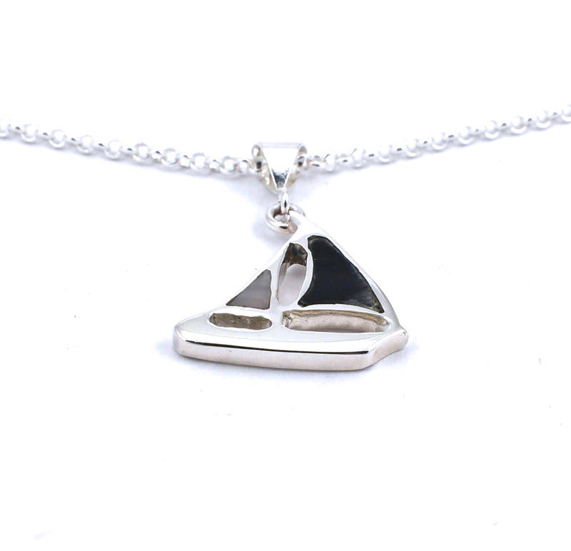 Bottom view of sterling silver sailboat pendant with hawkseye and mother of pearl gemstone inlay