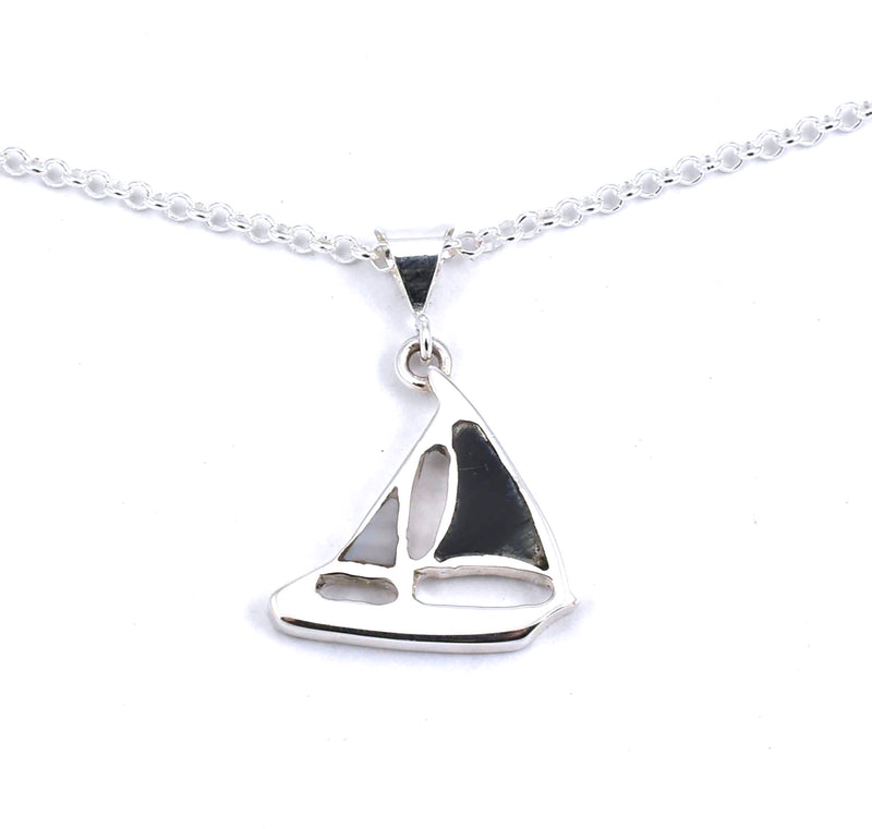 Front view of sterling silver sailboat pendant with hawkseye and mother of pearl gemstone inlay