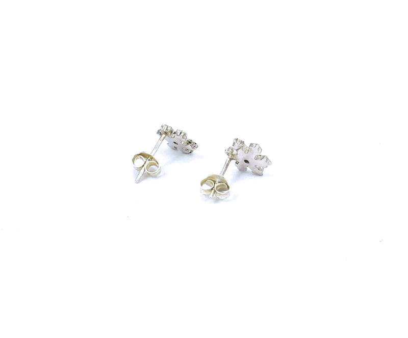 Rear view of sterling silver snowflake stud earrings with white sapphires