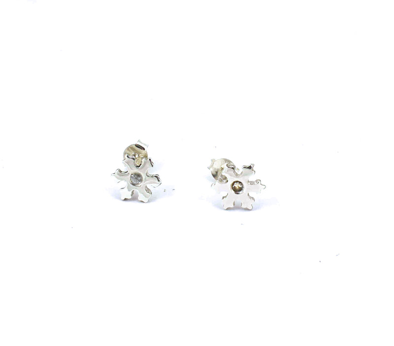 Front view of sterling silver snowflake stud earrings with white sapphires