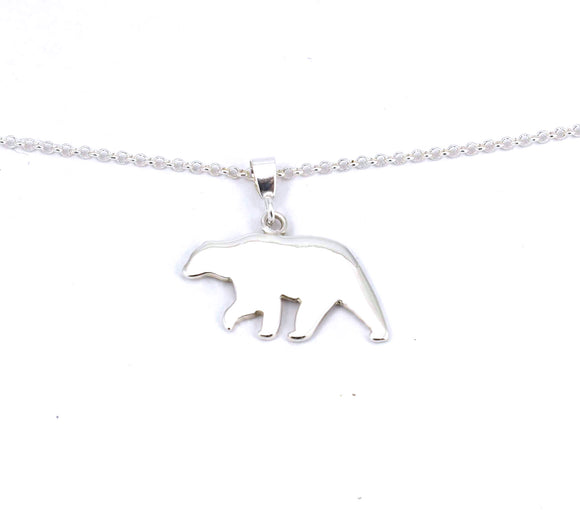 Front view of solid sterling silver polar bear silhouette pendant.