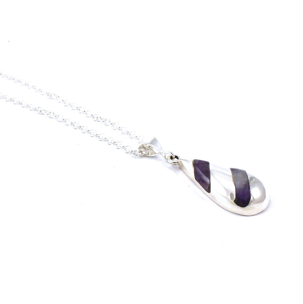 Left side view of Toddle Pendant with Amethyst Gemstone Inlay