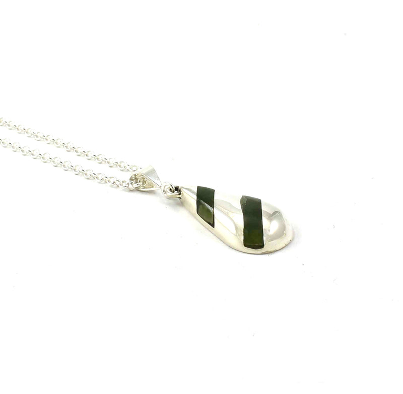 Left side view of Toddle Pendant with Jade Gemstone Inlay