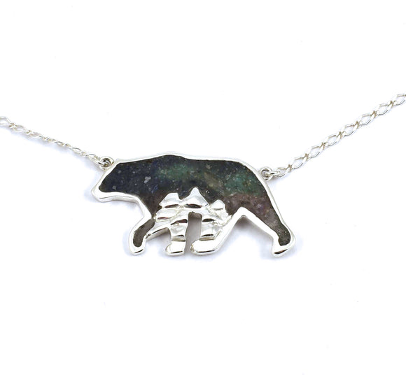 Front view of sterling silver ursa major bear pendant with crushed stone inlay