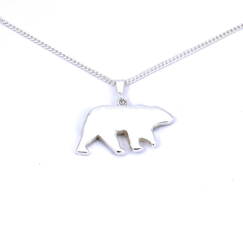 Rear view of medium sterling silver bear pendant with tree accent and crushed gemstone inlay