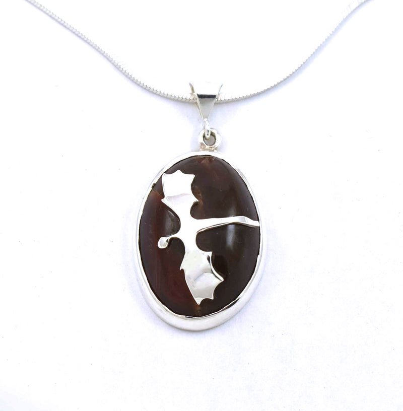 Front view of sterling silver red agate pendant with dragon accent