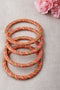 Baby Pink Golden Lehariya Lac Bangles (Set of 4)