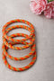 Orange Golden Lehariya Lac Bangles (Set of 4)
